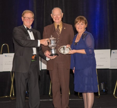 Dick Farmer with Jimmy Wofford and Diane Pitts accepting the Wofford Cup